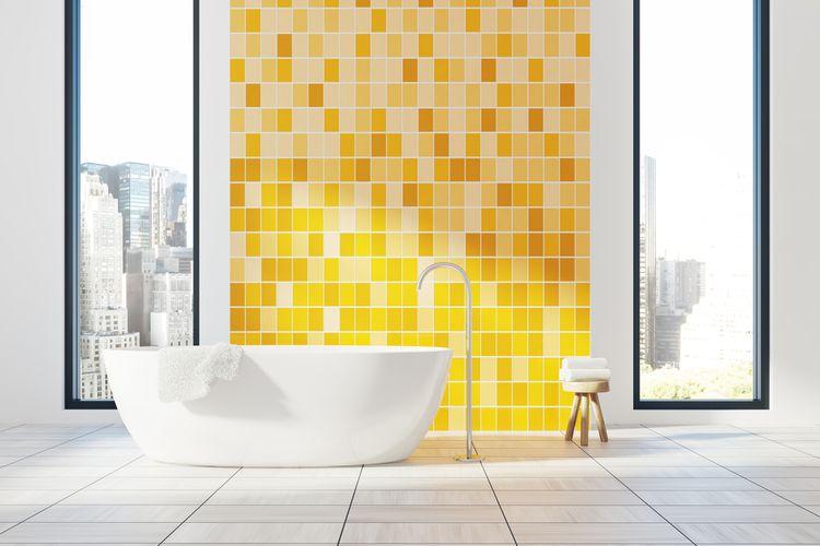 Žlutý obklad v koupelně