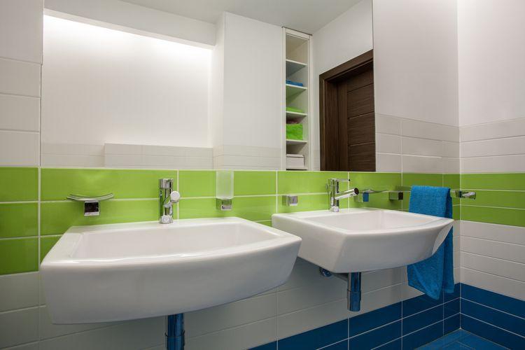 Zelené detaily v koupelně